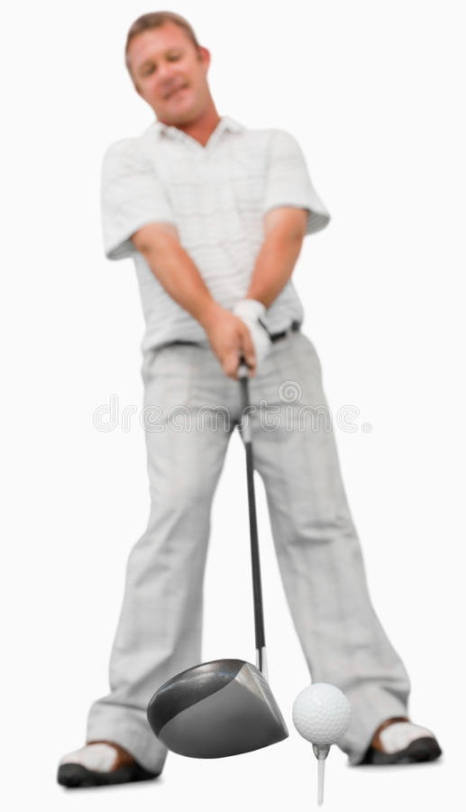 Golfer about to swing stock image