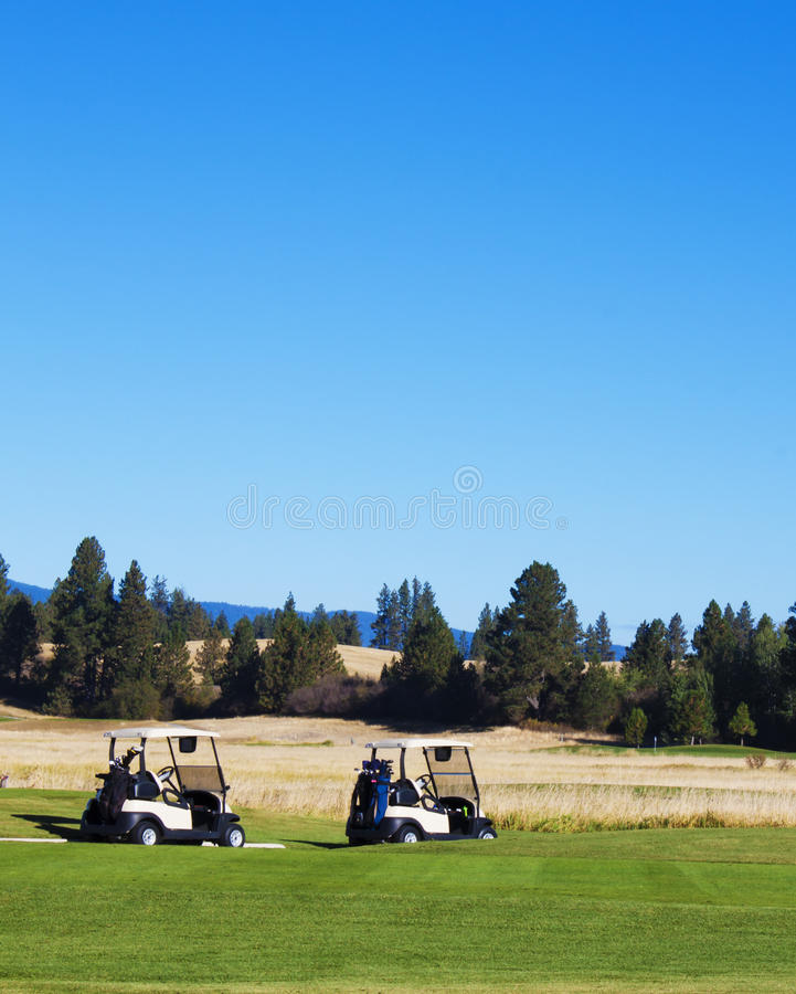 Golfers looking for the ball. Two random crats parked on the side of the road at the Golf Corse in Idaho royalty free stock photography