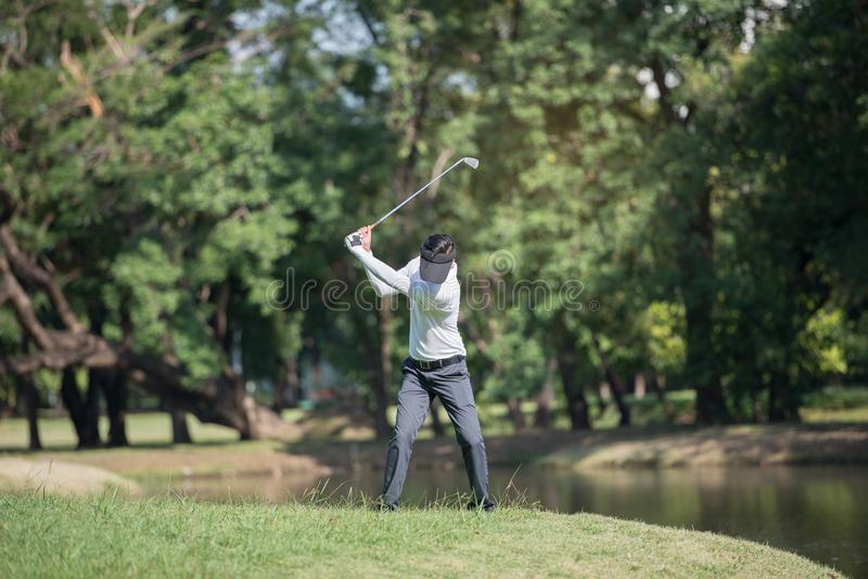 Golfers man show hit sweeping at green lawn stock images
