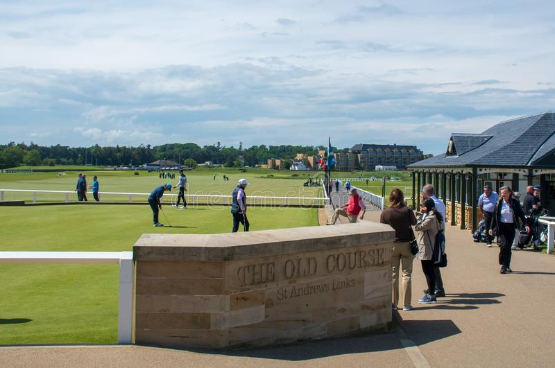 Golfers near Entrance of Iconic St Andrews Golf Course stock photography