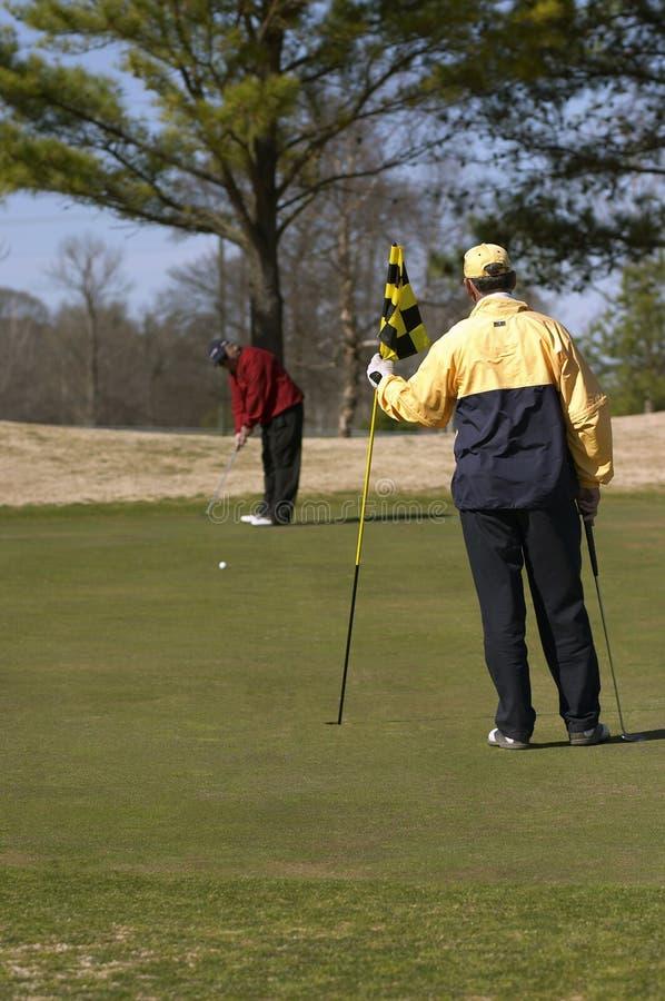 Golfers putting stock photos