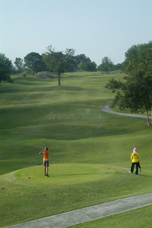 Golfeur après té-hors fonction image stock