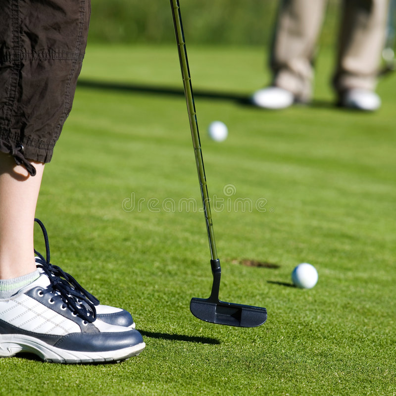 Golfing foto de stock