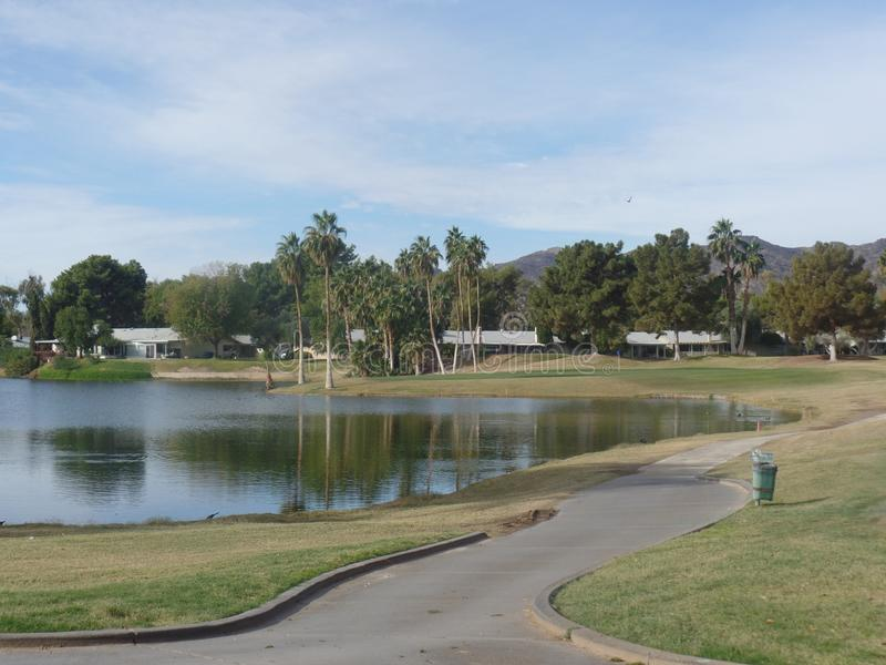 Golfing Great View of Mountains and Water royalty free stock photos