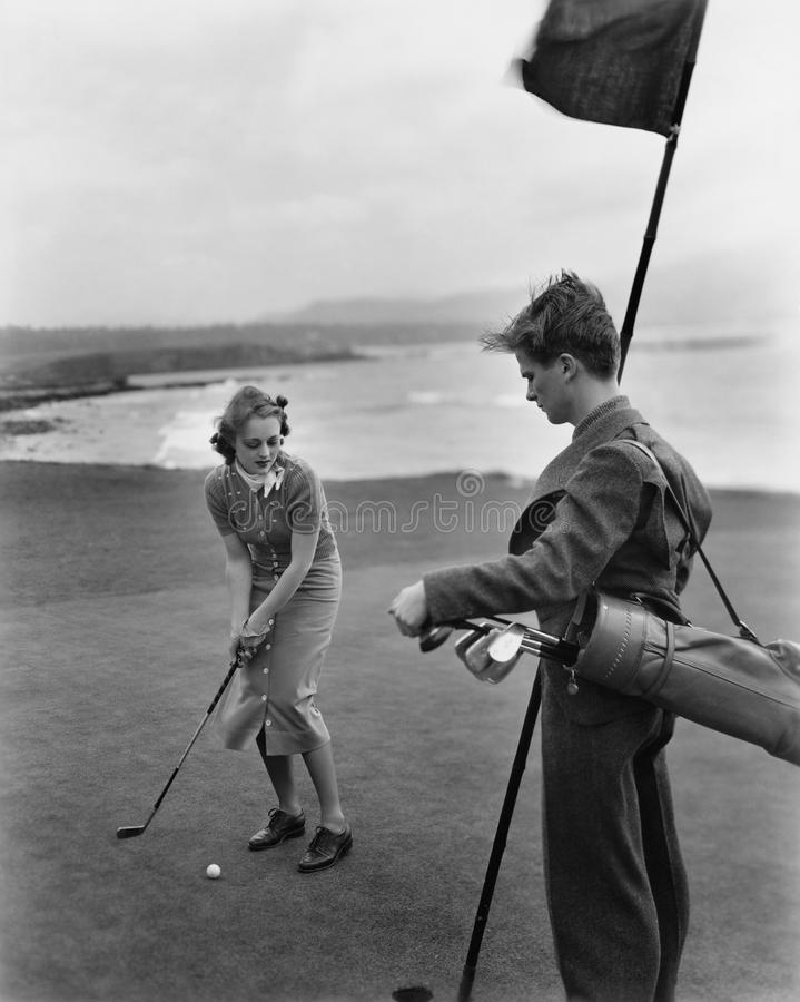 Golfing on the coast. (All persons depicted are no longer living and no estate exists. Supplier grants that there will be no model release issues royalty free stock photos