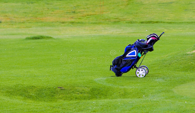 Golfing equipment in the bag stock photo