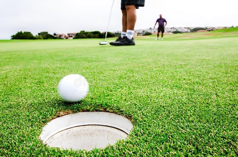 Golfing pairs stock photo