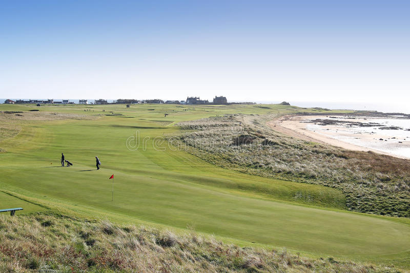 Golfing in Scotland. Golfers on the links in Fife, Scotland, near St Andrews, the home of golf royalty free stock photography