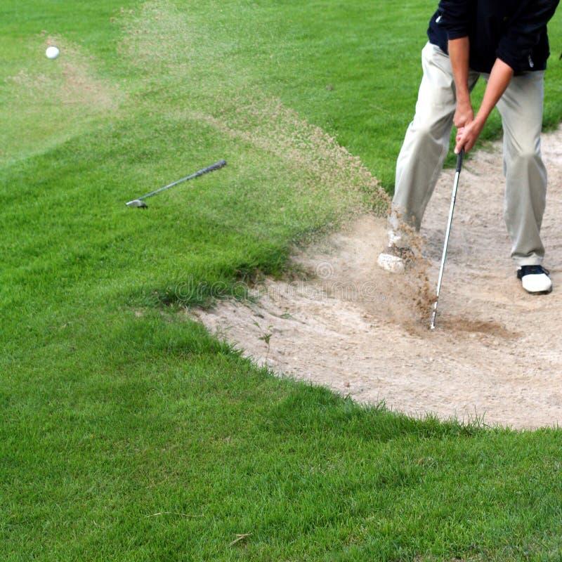 Golfista en la acción imágenes de archivo libres de regalías