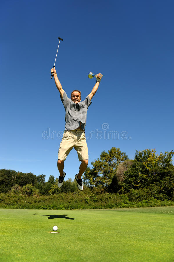 Golfista feliz foto de archivo libre de regalías