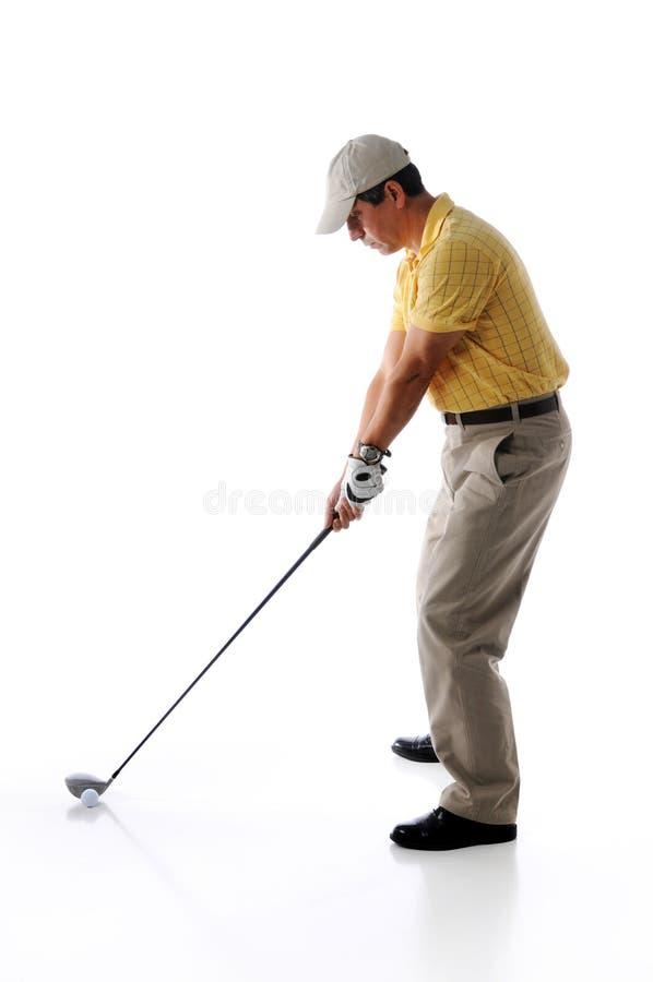 Golfista listo para hacer pivotar foto de archivo