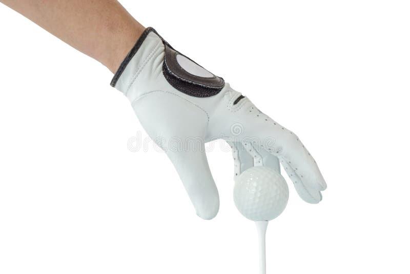 Golfista ręka w białej rękawiczkowej akci z piłką golfową na trójniku z whi fotografia royalty free