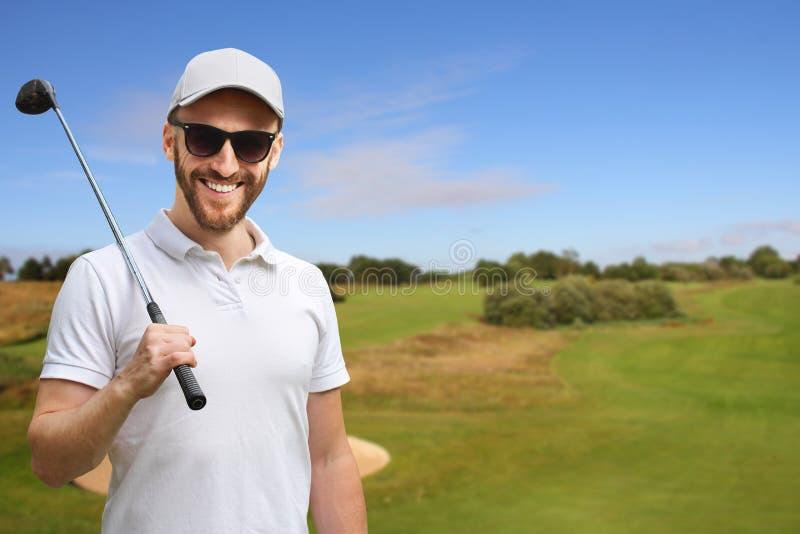 Golfista z kijem golfowym zdjęcia stock