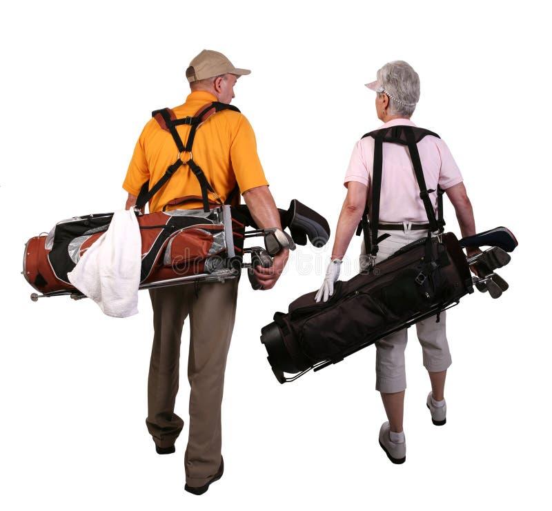 Golfistas maduros del hombre y de la mujer fotografía de archivo