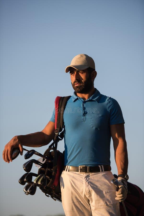 Golfisty portret przy polem golfowym na zmierzchu fotografia stock