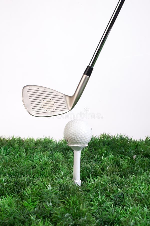 Golfklubben och klumpa ihop sig arkivbild