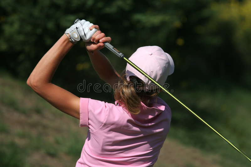 golfladyswing royaltyfri fotografi