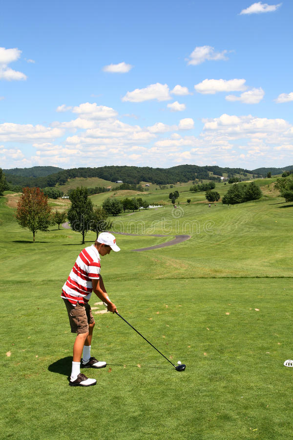 golfman av teeing barn arkivbilder