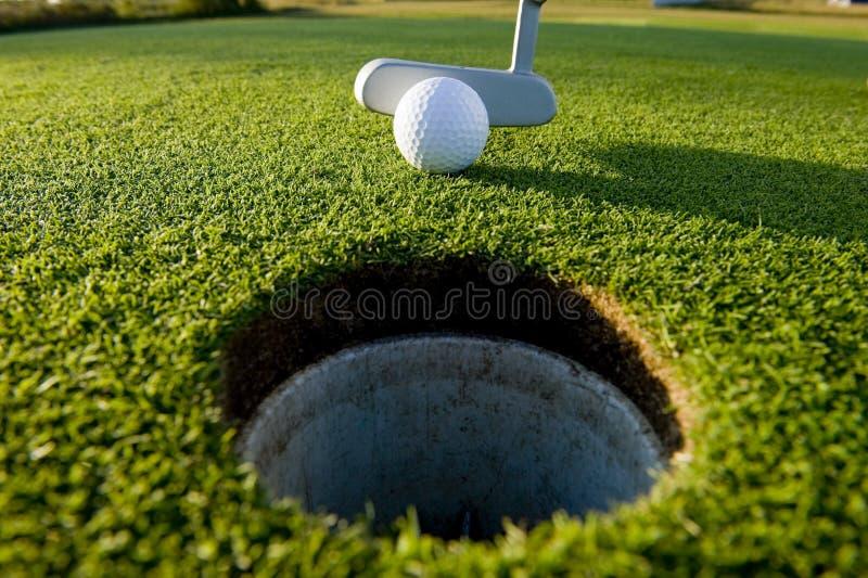 golfputt royaltyfri fotografi