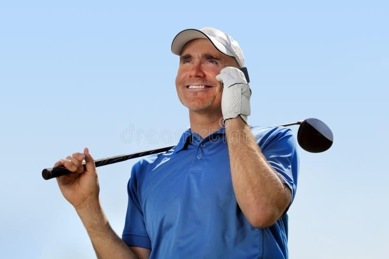 Golfspeler die mobiele telefoon met behulp van stock foto's