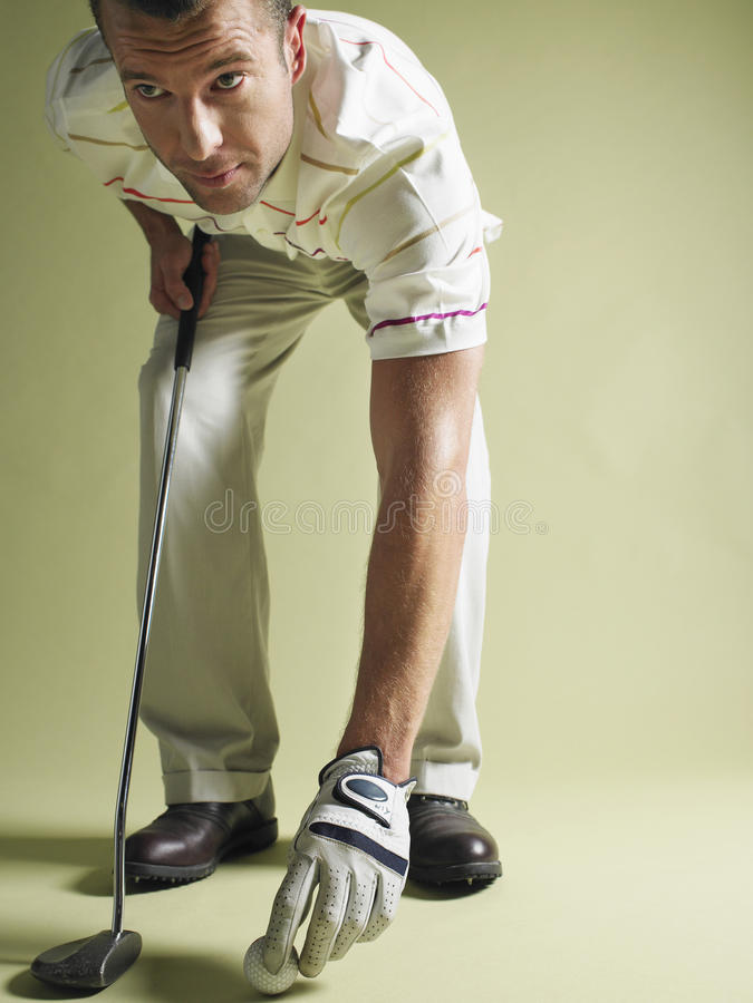 Golfspeler met Club en Bal stock foto