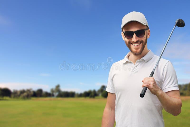 Golfspeler met golfclub stock afbeeldingen