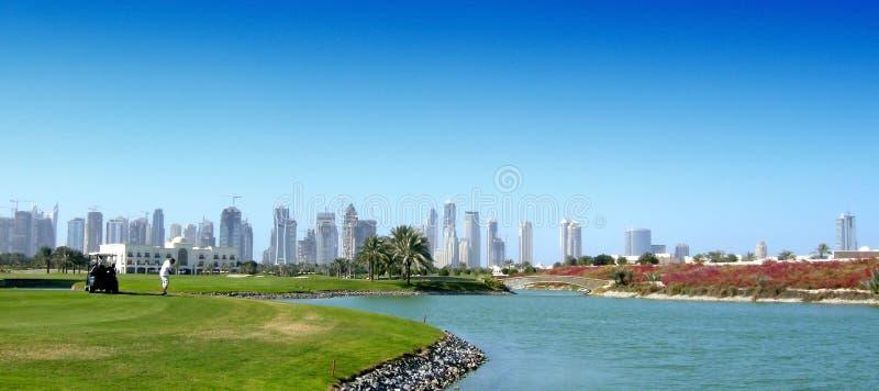 Golfspieler bei Dubai lizenzfreie stockfotos