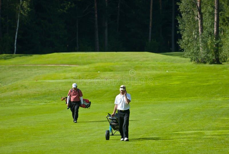 Golfspieler Zwei Auf Golf Feeld Redaktionelles Stockbild