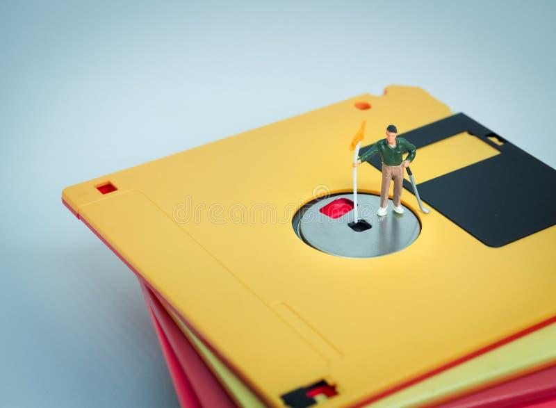Golfspielerstand auf der Diskette stockfotografie