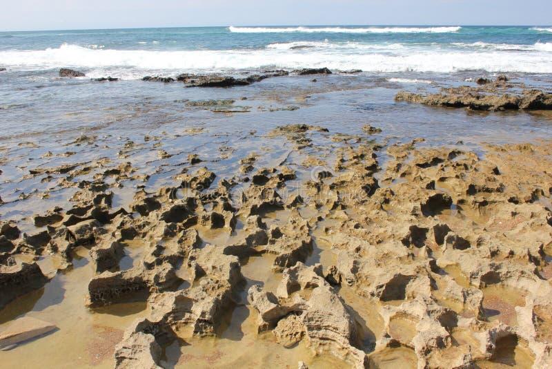 Golven en strand stock fotografie
