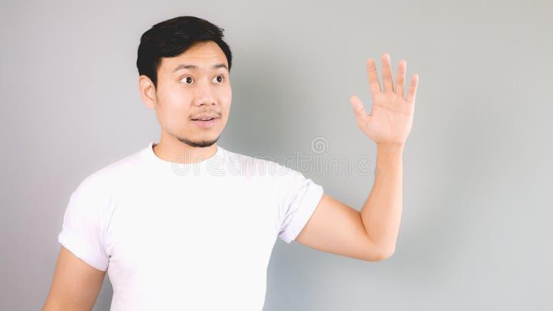 Golvende hand aan iemand zoals hallo of vaarwel stock afbeelding