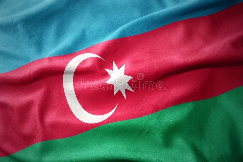 Golvende kleurrijke vlag van azerbaijan stock illustratie
