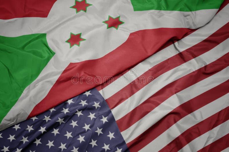 golvende kleurrijke vlag van de Verenigde Staten van Amerika en nationale vlag van Burundi royalty-vrije stock afbeeldingen