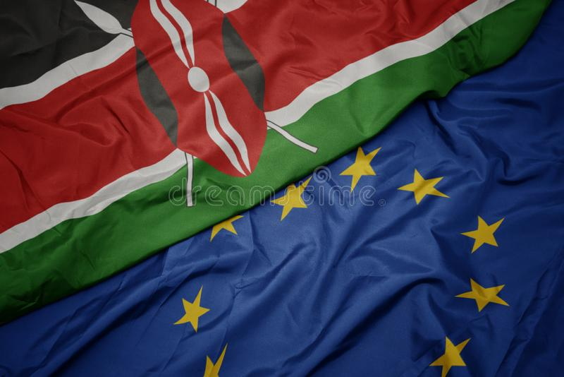 golvende kleurrijke vlag van Europese Unie en vlag van Kenia royalty-vrije stock foto