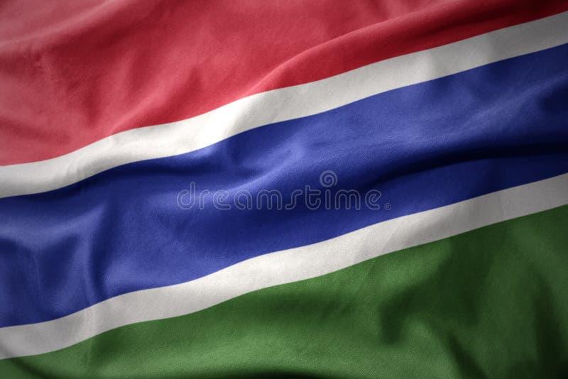 Golvende kleurrijke vlag van Gambia stock foto's