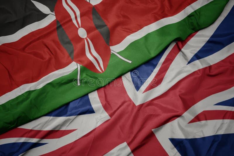 golvende kleurrijke vlag van Groot-Brittannië en nationale vlag van Kenia stock foto