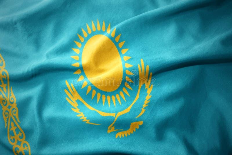 Golvende kleurrijke vlag van Kazachstan stock foto