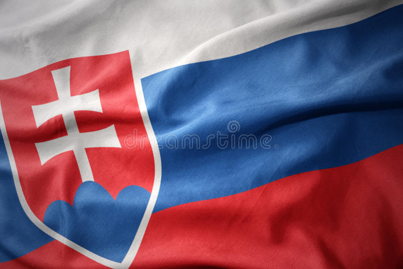 Golvende kleurrijke vlag van Slowakije stock fotografie