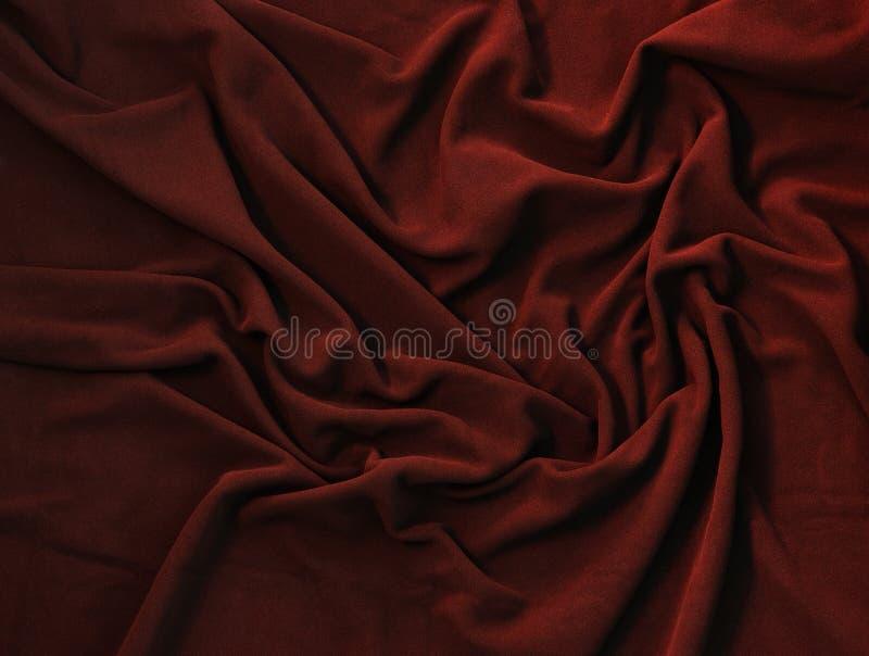 Golvende textuur van donkerrode vacht stock foto