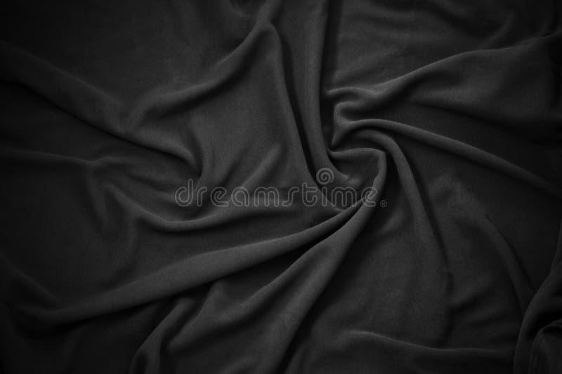Golvende textuur van zwarte vacht stock afbeelding
