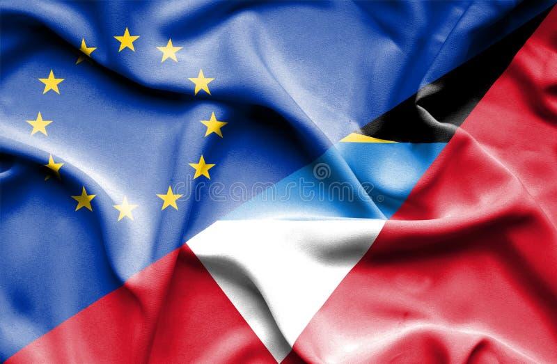Golvende vlag van Antigua en Barbuda en de EU royalty-vrije stock foto's
