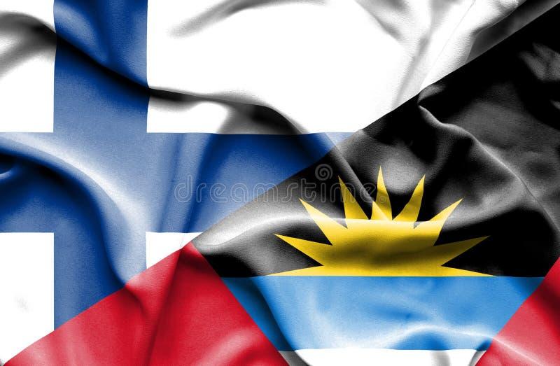 Golvende vlag van Antigua en Barbuda en Finland royalty-vrije stock foto