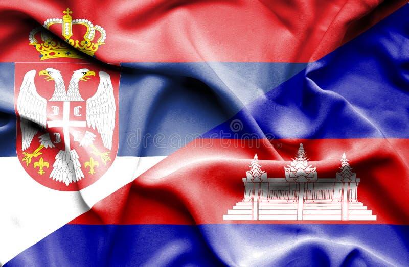 Golvende vlag van Kambodja en Servië stock illustratie