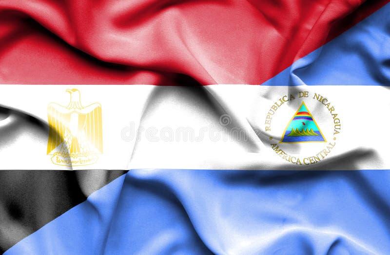 Golvende vlag van Nicaragua en Egypte stock afbeelding