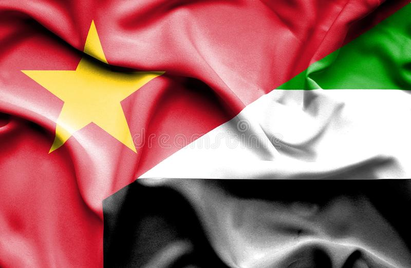 Golvende vlag van Verenigde Arabische Emiraten en Vietnam stock foto's