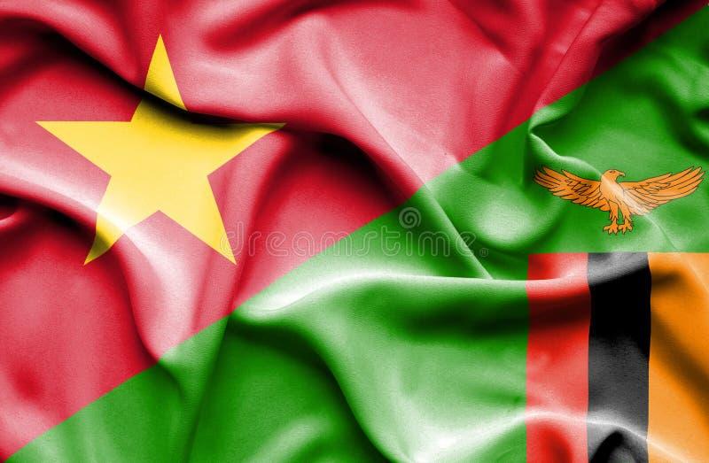 Golvende vlag van Zimbabwe en Vietnam stock afbeelding