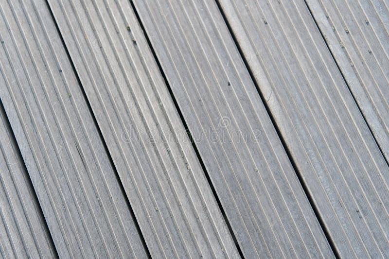 Golvet av grå färger stiger ombord i reykjavik, Island Wood utomhus- golvtextur Timmeryttersida på träbakgrund Durkbakgrund w arkivfoto