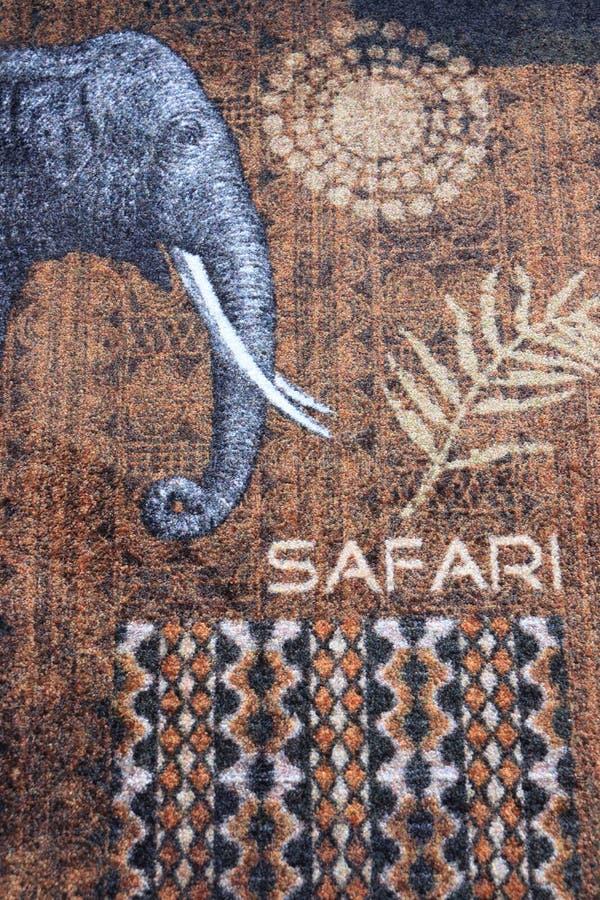 Golvmattans dekoration africa elephant-design på den arkivbild