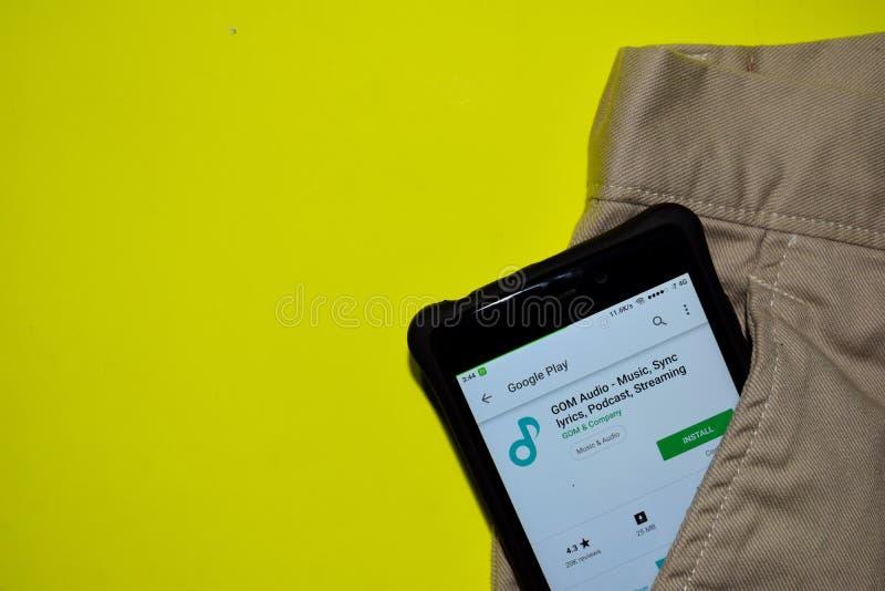 GOM Audio - Music, Sync lyrics, Podcast, Streaming dev application on Smartphone screen. royalty free stock photography