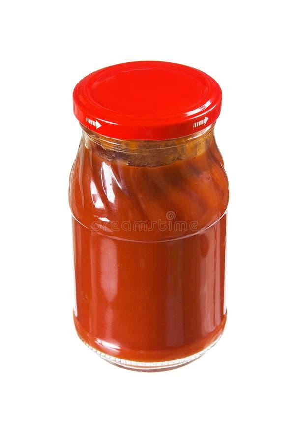Goma de tomate del tarro imagen de archivo